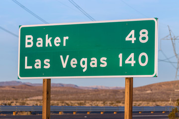 Tuinposter Las Vegas Late afternoon view of Las Vegas 140 miles highway sign on I-15 near Barstow in California.