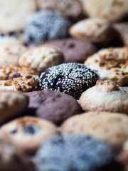 A lot of different cookies filling the whole picture, with different depth of field frame. Sweet for evereone.