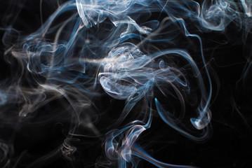 Smoke fragments on a black background