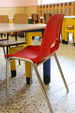 red chair for children inside the school classroom