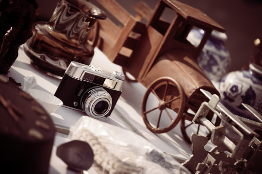 Vintage camera, tiny car and more on a flea market
