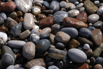 The wet pebbles on the beach.