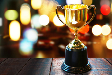 Trophy on wood table with abstract bokeh background