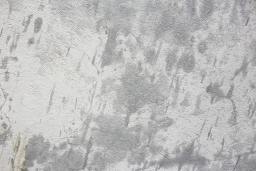 rough texture of a old gray wet wall with rain drops