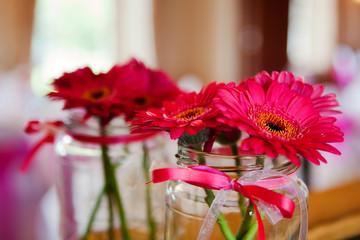 Pink dahlias in a glass jam jar