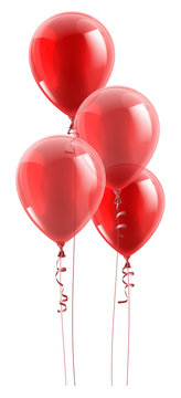 A set of red party balloons floating in the air.