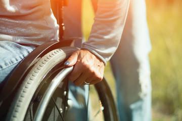 Close-up of hand on pushrim of wheelchair
