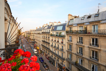 Paris, ancient buildings facades and street in a warm summer sunset in France Wall mural