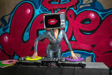 tv head woman and graffiti wall dj