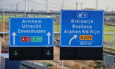 Green arrow above the driving lane indicating that its open on motorway A12 E30 heading Arnhem, utrecht and Zevenhuizen and junction 8 to N209 local road to Alphen aan den Rijn, Boskoop and Bleiswijk