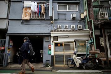 Eiraku sushi restaurant is seen along Medaka shopping street in Tokyo