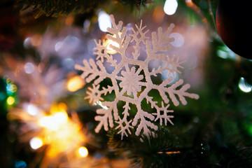 Christmas decoration snowflake on the Christmas tree