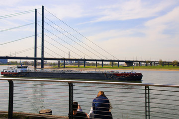 A couple is looking at the river rhine, city of Dusseldorf - Germany