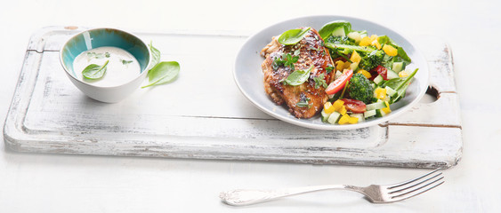 Chicken breast with fresh vegetable salad
