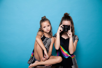 two beautiful girls doing a snapshot camera