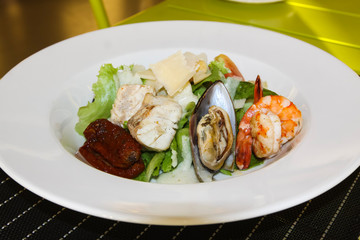 Seafood salad. Table setting in a restaurant.