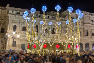 Long exposure photography of Christmas decoration lights in city hall of Seville