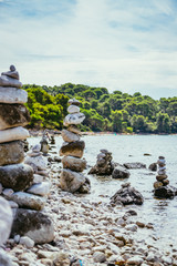 Spiritual stonemen at the coast of Croatia, ocean