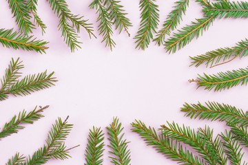 Christmas composition. Creative layout fir green branches on white background. Square frame with christmas tree branch. Flat lay, top view, copy space. Funky neon colors, trendy minimal concept.