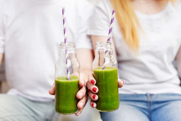 Young couple drinking green smoothie. Healthy life style concept.