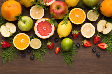 Summer fruit and berries assortment on wooden background