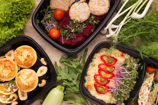 Different types of takeaway food in microwavable containers