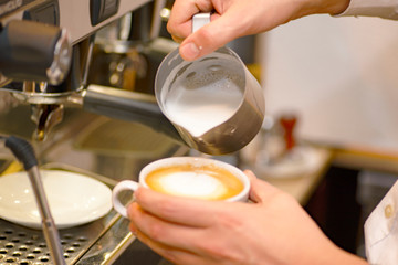 barista making latte coffee