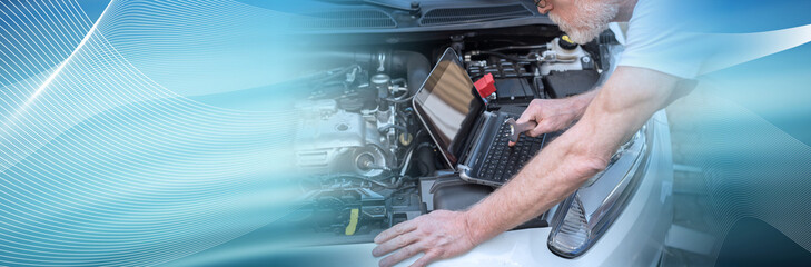 Mechanic using laptop for checking car engine. panoramic banner
