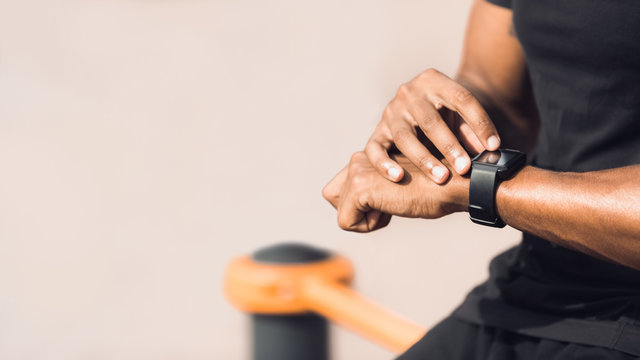 Man using black smart watch, checking heart rate