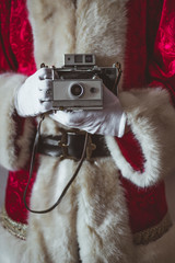 Santa Claus with vintage camera, partial view