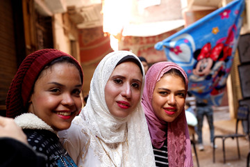 Nadia Mohammad Salem and her friends pose for a picture after Salem and her husband signed their marriage contract, in Cairo