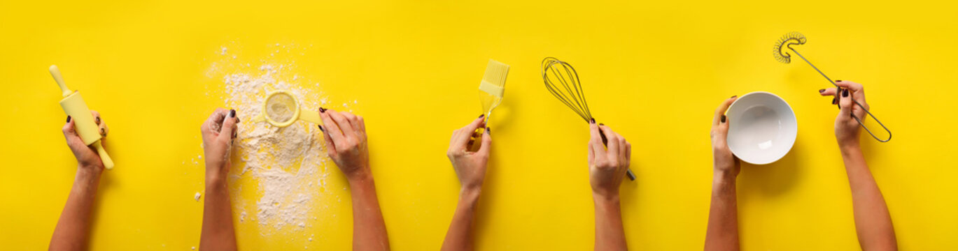 Female hands holding kitchen tools, sieve, rolling pin, bowl, sieve, brush, whisk, spatula for baking and cooking over yellow background. Food frame, bake concept with copy space