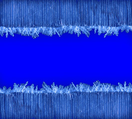winter holiday Christmas new year background frame of macro photo frost on old wooden planks with blue space for text