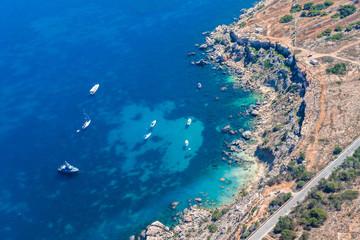 Rdum Il-Hmar cliffs and nice dive site between massive boulders near Mellieha in Northern Region of Malta.