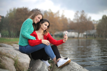 Friends enjoying a day at the lake, taking a photo