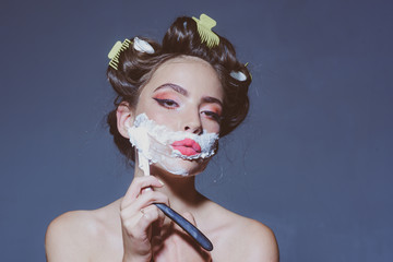 morning grooming and skincare. pin up woman with trendy makeup. retro woman shaving with foam and...
