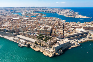 Historical Valetta, capital city of Malta, Grand harbour, Gzira and Sliema towns, Manoel Island in Marsamxett bay from above. Skyscraper in Paceville district is in the background. Malta aerial view.