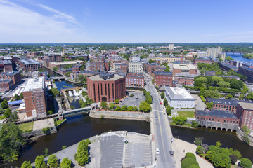 Lowell historic downtown and Concord River aerial view in Lowell, Massachusetts, USA.