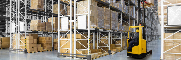 A large distribution warehouse with yellow forklift