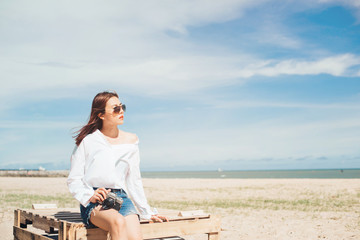 Woman traveler taking a photo at the beach, Beautiful and enjoy view.