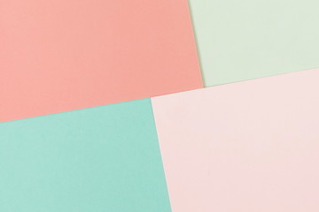 Abstract geometric paper background in pastel colors. fashion trend colors living coral and mint. Minimal concept. Flat lay, Top view. Copy space