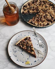 Crumble pie with honey on plate