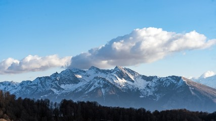 Peak of the mountain covered by snow, winter in Sochi, Russia.