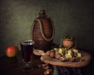 Still life with cheese and red wine