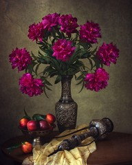 Still life with bouquet of magenta  peonies