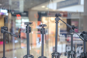 Photo and video tripods in the store of photo goods in the mall