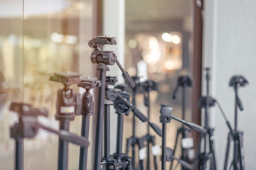 several tripods of different heights and other manufacturers for photo video shooting in the store