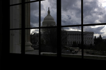 The U.S. Capitol dome sits beneath a cloudy sky as budget legislation deadlines loom for a potential federal government shutdown in Washington