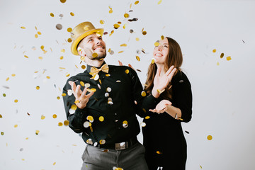 Couple throwing confetti at Party