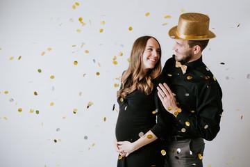 Pregnant Couple with Confetti